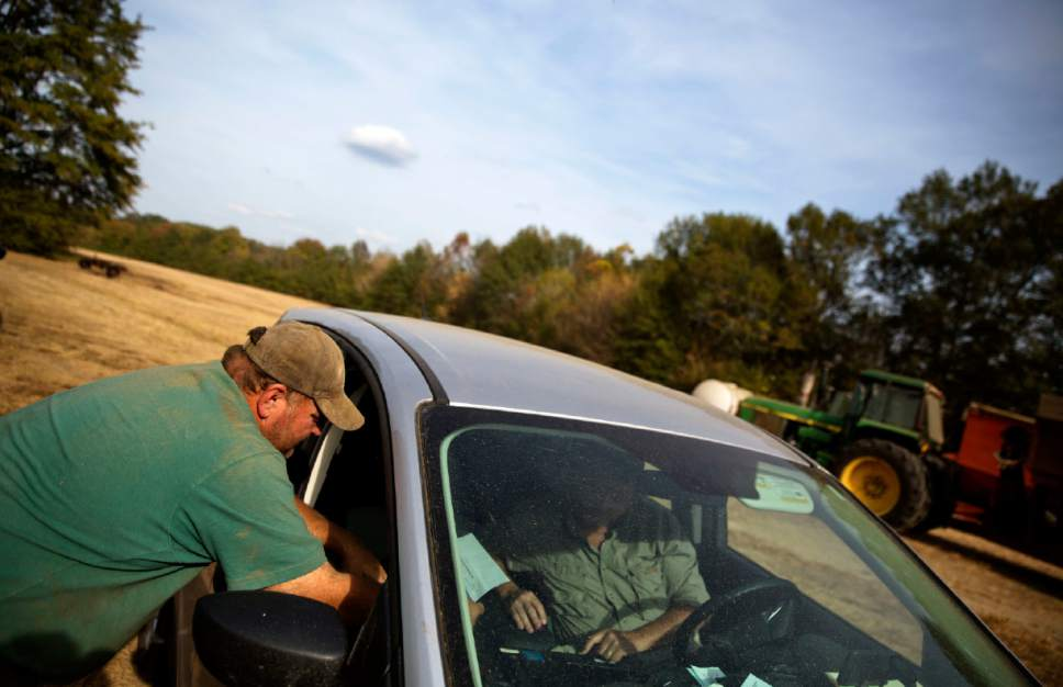 In this Wednesday, Oct. 26, 2016 photo, farmer Michael Womack meets with his insurance adjuster after his corn and soybean harvests were affected by drought conditions in Tallapoosa, Ga. Womack estimates his corn production was cut in half because of the drought. Some of the South's most beautiful mountains and valleys this fall are filled with desperation, as a worsening drought kills crops, threatens cattle and sinks lakes to their lowest levels in years. (AP Photo/David Goldman)