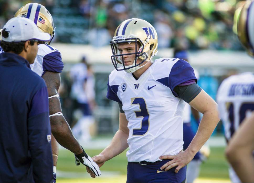 Washington quarterback Jake Browning (3) warms up before playing Oregon, in an NCAA college football game Saturday, Oct. 8, 2016, in Eugene, Ore.  (AP Photo/Thomas Boyd)