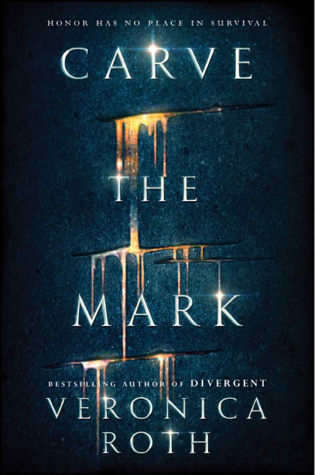 "This book cover image released by Katherine Tegen Books shows ""Carve The Mark,"" by Veronica Roth. Roth's book, the first of two planned volumes, comes out in mid-January and she will visit 10 cities, starting in New York on Jan. 17. (Katherine Tegen Books via AP)"