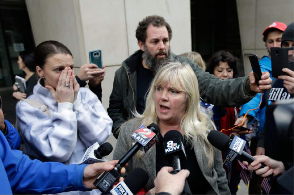 Defendant Shawna Cox speaks outside federal court in Portland, Ore., Thursday, Oct. 27, 2016. A jury exonerated brothers Ammon and Ryan Bundy and five others of conspiring to impede federal workers from their jobs at the Malheur National Wildlife Refuge. (AP Photo/Don Ryan)