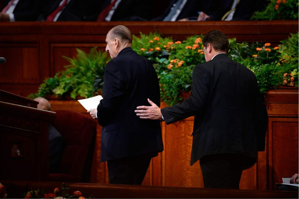 Scott Sommerdorf   |  The Salt Lake Tribune   President Thomas S. Monson is helped to the lectern prior to his short talk at the 186th Semiannual General Conference of the LDS church, Sunday, October 2, 2016.