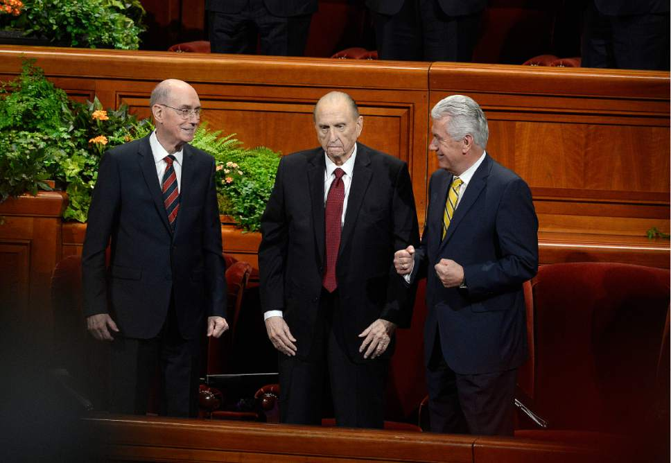 Scott Sommerdorf   |  The Salt Lake Tribune   President Thomas S. Monson, center, stood prior to singing a hymm with First Counselor Henry B. Eyring, left, and Second Counselor Dieter F. Uchtdorf at right at the afternoon session of the 186th Semiannual General Conference of the LDS church, Sunday, October 2, 2016. At left is