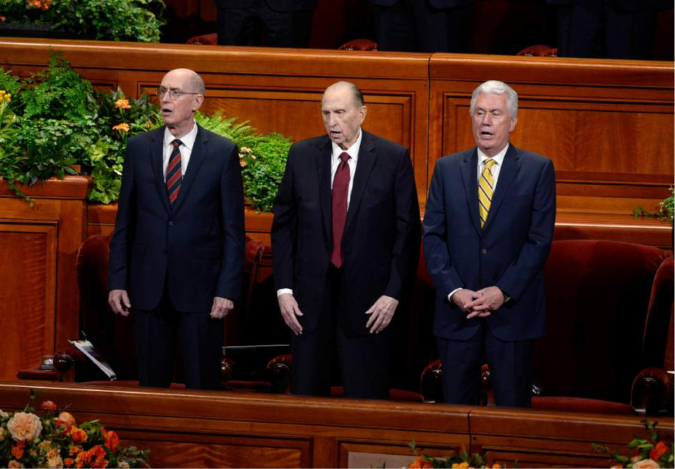 Scott Sommerdorf   |  The Salt Lake Tribune   President Thomas S. Monson, center, sings a hymm with First Counselor Henry B. Eyring, left, and Second Counselor Dieter F. Uchtdorf at right at the afternoon session of the 186th Semiannual General Conference of the LDS church, Sunday, October 2, 2016. At left is