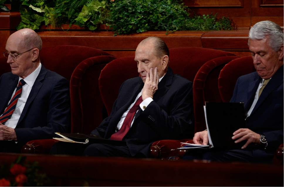 Scott Sommerdorf   |  The Salt Lake Tribune   President Thomas S. Monson, center, sits prior to speaking at the 186th Semiannual General Conference of the LDS church, Sunday, October 2, 2016. At left is First Counselor Henry B. Eyring, and Second Counselor Dieter F. Uchtdorf at right.