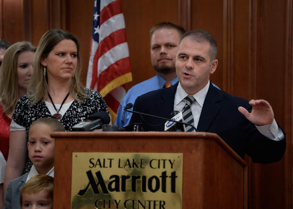 Scott Sommerdorf   |  The Salt Lake Tribune Rick Koerber's attorney Marcus Mumford began a news conference the day after a federal judge tossed out 18 charges against Koerber that had alleged he operated a giant Ponzi scheme through his real estate company, Friday, August 15, 2014. Koerber's wife Jewel Skousen is at left.
