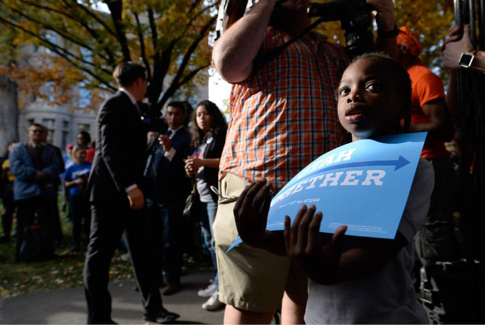 Francisco Kjolseth | The Salt Lake Tribune Aziza Landau, 6, patiently awaits the arrival of Donna Brazile, chairwoman of the DNC, as she arrives for a rally in support of Hillary Clinton and other Democrats races at the Salt Lake City and County building on Thursday, Oct. 27, 2016.