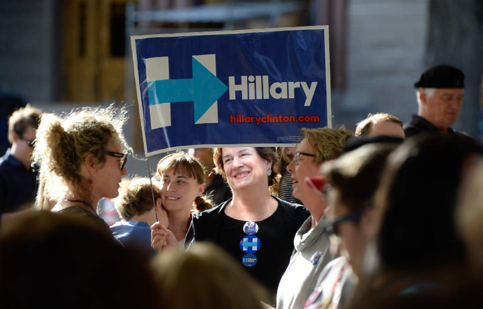 Francisco Kjolseth | The Salt Lake Tribune Merry Harrison, center, joins others supporting Hillary Clinton for president as they wait for the arrival of Donna Brazile, chairwoman of the DNC, during a rally stop at the Salt Lake City and County building on Thursday, Oct. 27, 2016.
