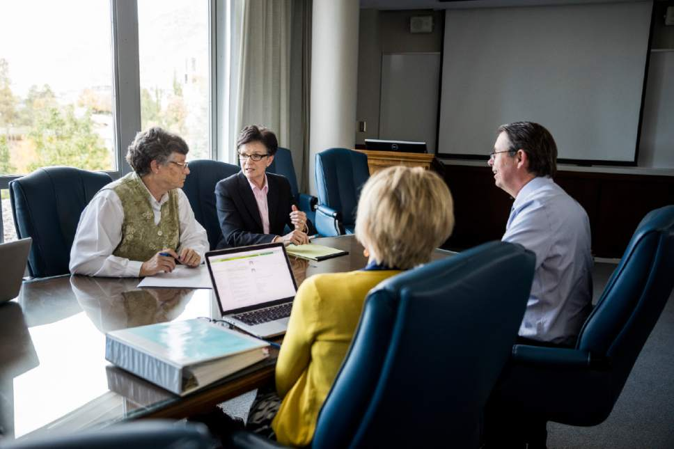 Photo courtesy of Brigham Young University | Sandra Rogers, left, Jan Scharman, Julie Valentine and Ben Ogles, members of Brigham Young University's Advisory Council on Campus Response to Sexual Assault, meeting earlier this month.
