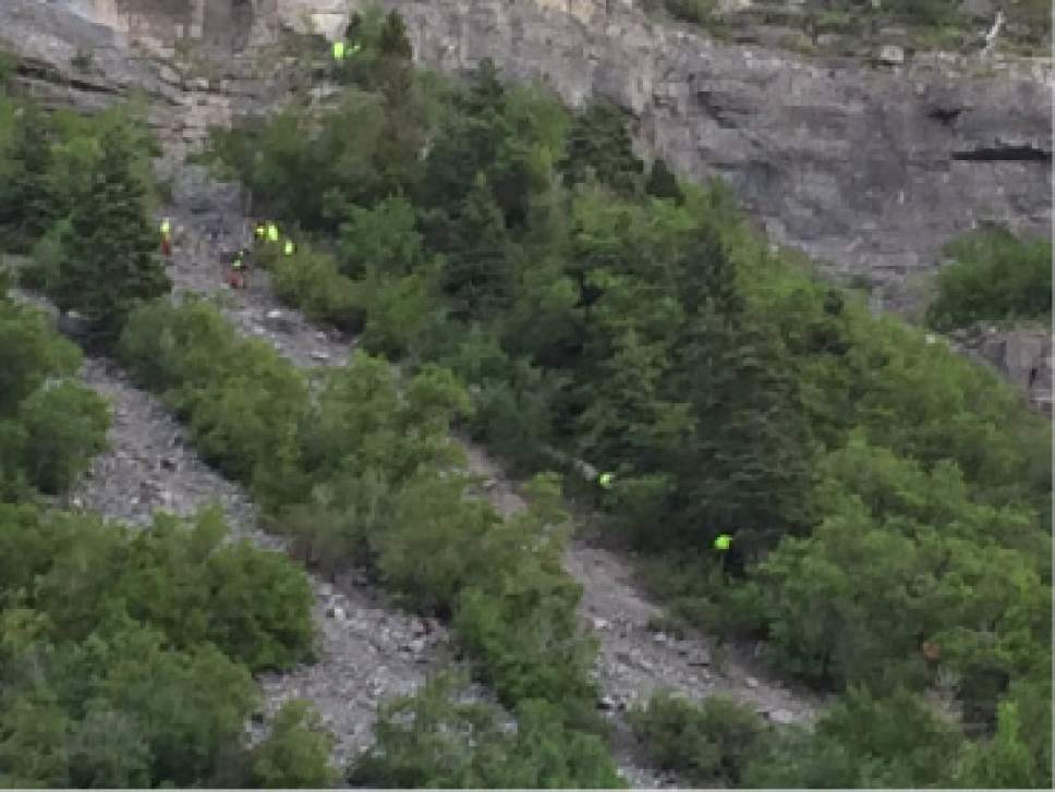 Courtesy  |  Utah County Sheriff's Office  A boy was injured near Bridal Veil Falls on Monday after a football-sized rock hit his head. Rescue crews lowered him down the mountain through a series of anchoring systems.