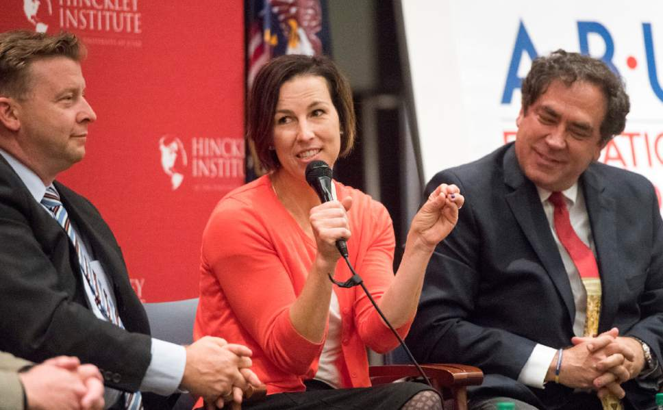 Rick Egan  |  The Salt Lake Tribune  Sen. Todd Weiler (left) listens as State House Democratic candidate Suzanne Harrison speaks during a panel discussion at the Hinckley Institute, during a discussion on how religion and politics mix, Monday, October 3, 2016.  Utah State Rep. Brian King is on the right.