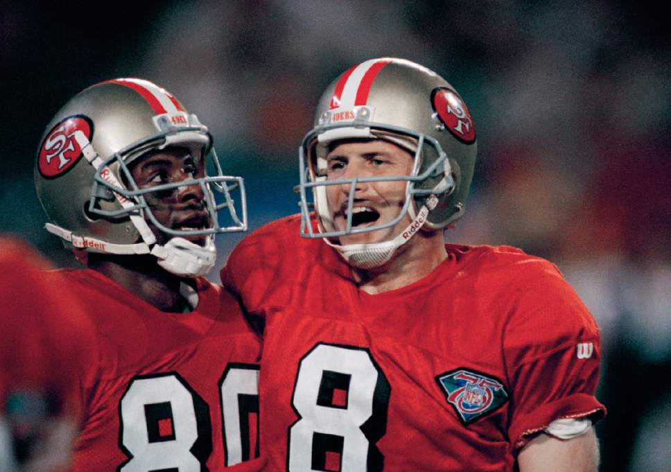FILE - In this Jan. 29, 1995, file photo, San Francisco 49ers quarterback Steve Young (8) celebrates with wide receiver Jerry Rice after a third-quarter touchdown pass at Joe Robbie Stadium in Miami during NFL football's Super Bowl XXIX. Young threw a record six touchdown passes, and the 49ers became the first team to win five Super Bowls. (AP Photo/David Longstreath, File)