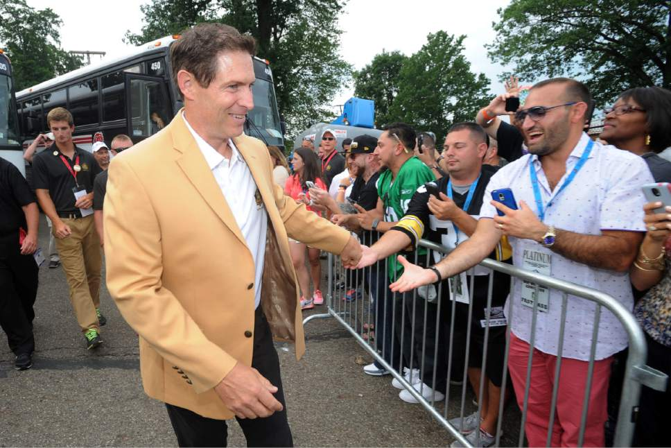 Pro Football Hall of Famer Steve Young arrives for an induction ceremony for the class of 2015 at the Pro Football Hall of Fame Saturday, Aug. 8, 2015, in Canton, Ohio.  (AP Photo/Don Wright)