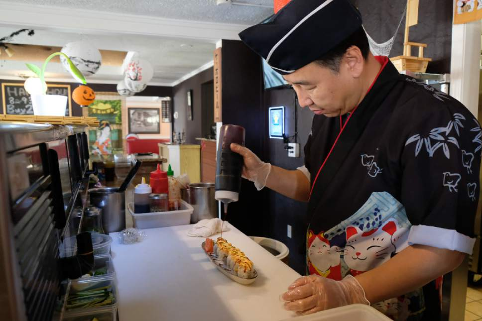 Francisco Kjolseth  |  The Salt Lake Tribune Jinwoo Shin, chef and owner Hanabi Sushi in Midvale, prepares a Confidential sushi roll during a recent lunch rush.