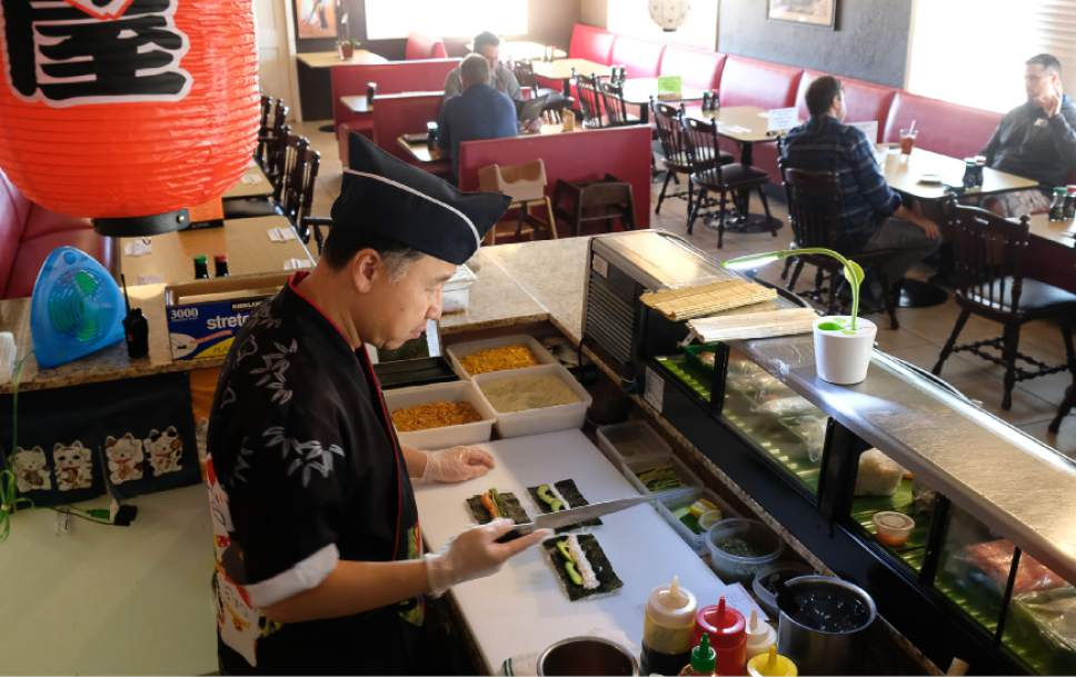 Francisco Kjolseth  |  The Salt Lake Tribune Jinwoo Shin, chef and owner Hanabi Sushi in Midvale, prepares lunch orders for guests of the restaurant that opened in April.