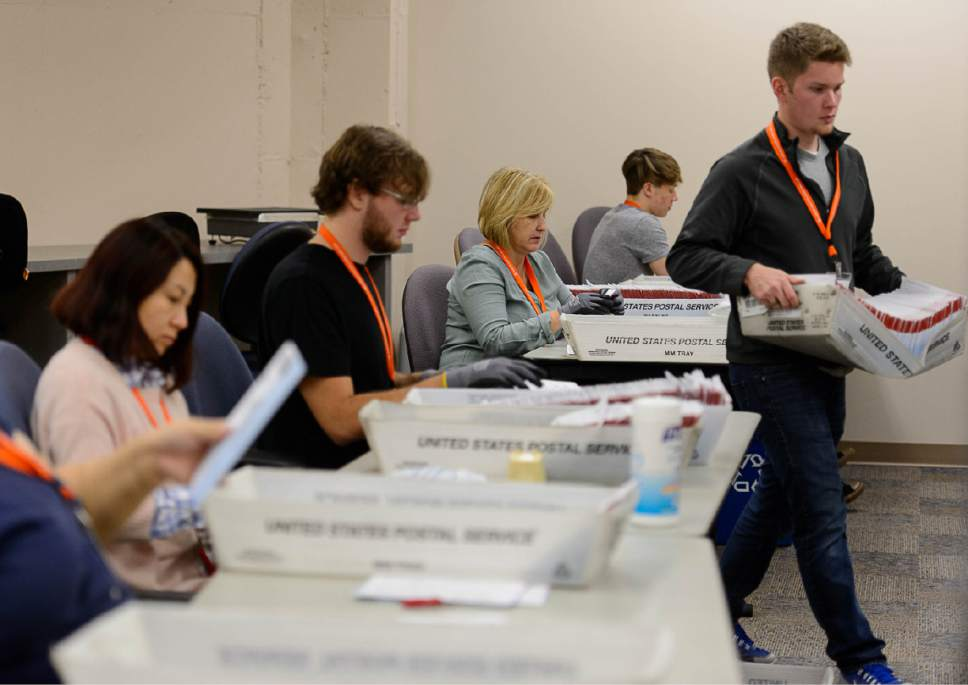 Trent Nelson  |   Tribune file photo Employees in Salt Lake County's Election Division prepare mail in ballots to be sorted and counted at the Salt Lake County Government Center in Salt Lake City, Tuesday October 18, 2016.