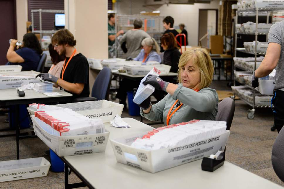 Trent Nelson  |  The Salt Lake Tribune Employees in Salt Lake County's Election Division prepare mail in ballots to be sorted and counted at the Salt Lake County Government Center in Salt Lake City, Tuesday October 18, 2016.