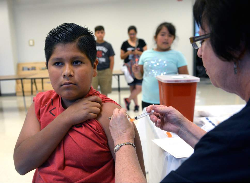 Al Hartmann  |  The Salt Lake Tribune  Alexis Herrera, 11, remains tough as he gets an immuzation shot for school at the Junior League CARE Fair in the Horizonte Center in Salt Lake City in July. It's Utah's largest free health fair, requiring no appointments or insurance for services such as immunizations, vision, hearing and speech screenings and dental exams. The number of uninsured Utah children dropped to 65,000 in 2015, but the state still ranks poorly compared to others across the country, according to a recent report.