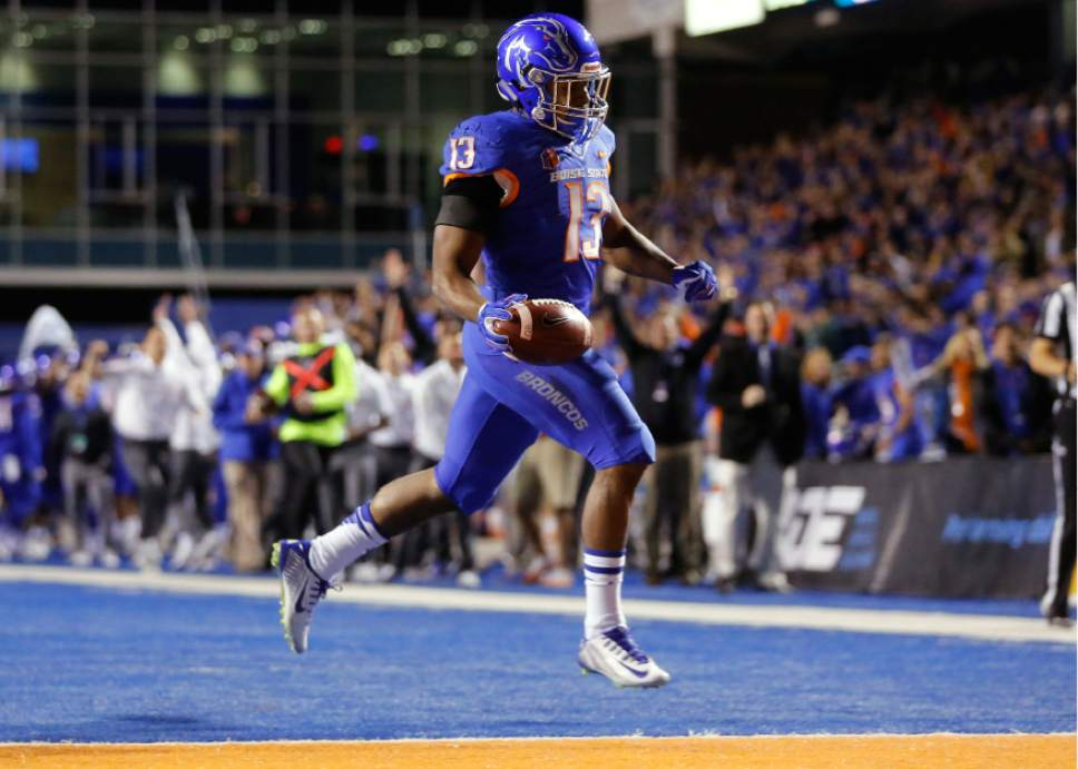 Boise State running back Jeremy McNichols scores a touchdown during the first half of an NCAA college football game against BYU in Boise, Idaho, Thursday, Oct. 20, 2016. (AP Photo/Otto Kitsinger)