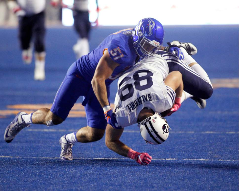 BYU tight end Tanner Balderree (89) is brought down by Boise State linebacker Ben Weaver (51) during the first half of an NCAA college football game in Boise, Idaho, Thursday, Oct. 20, 2016. (AP Photo/Otto Kitsinger)
