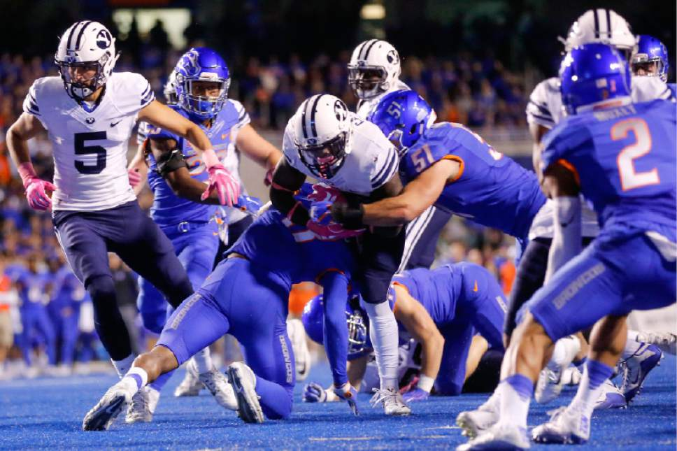 BYU running back Squally Canada is brought down by Boise State defenders, including linebacker Ben Weaver (51), during the first half of an NCAA college football game in Boise, Idaho, Thursday, Oct. 20, 2016. (AP Photo/Otto Kitsinger)