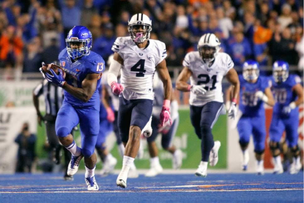 Boise State running back Jeremy McNichols (13) runs on a long touchdown past BYU linebacker Fred Warner (4) during the first half of an NCAA college football game in Boise, Idaho, Thursday, Oct. 20, 2016. (AP Photo/Otto Kitsinger)
