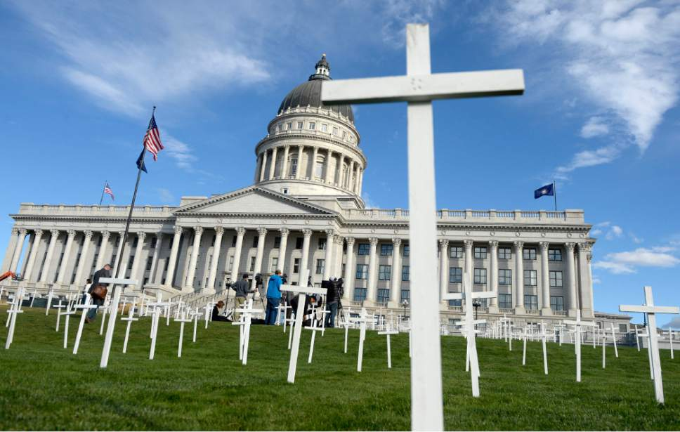 AAl Hartmann     The Salt Lake Tribune 361 crosses were placed on the front lawn of the Utah State Capitol Thursday Oct. 21 for Alliance for a Better Utah to make a visual point for their press conference.  Today marks 657 days since the Utah Legislature had the first opportunity to grant access to affordable healthcare for thousands of Utahns most in need. Better Utah estimates that as many as 361 Utahns (represented by the rows of crosses) have died because they don't have access to affordable healthcare.
