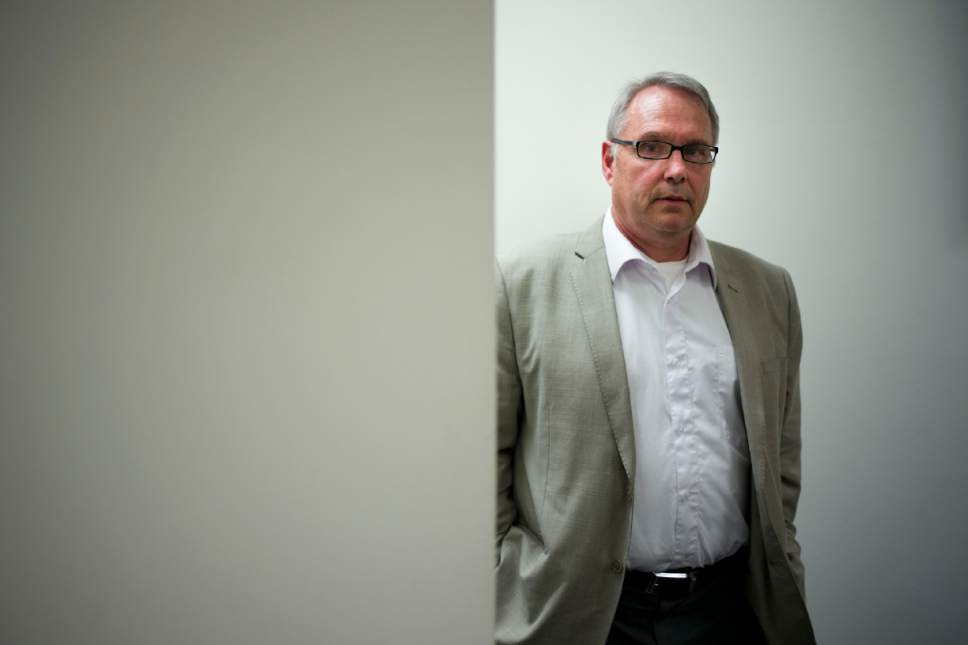 Attorney William Johnson, a leader of the American Freedom Party and self-proclaimed white nationalist, pauses for photos in his office, Tuesday, May 10, 2016, in Los Angeles. Donald Trump's campaign says a computer problem resulted in the prominent white nationalist being included on a list of his potential California delegates. The campaign says the name has been withdrawn and a corrected list resubmitted to state officials. (AP Photo/Jae C. Hong)