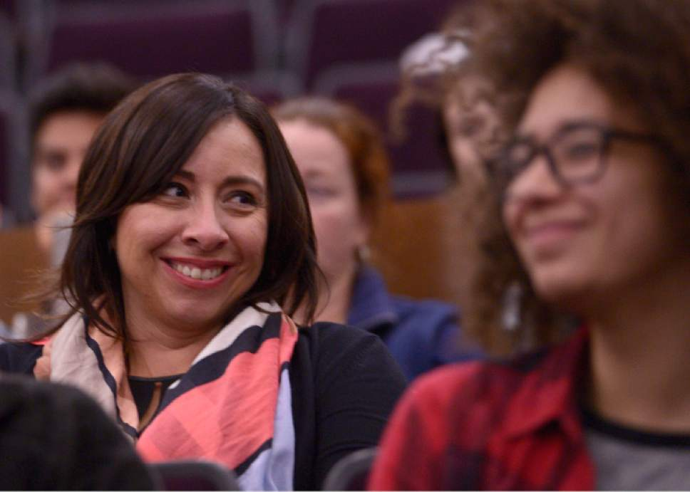 "Leah Hogsten  |  The Salt Lake Tribune Rep. Angela Romero smiles as a member of the audience applauded her efforts to pass legislation regarding sexual assaults. The Salt Lake Tribune's panel discussion  ""Confronting Rape Culture: A Conversation about Consent,"" that discussed consent and how to change cultures that foster sexual assault at the University of Utah's S.J. Quinney College of Law, Wednesday, November 2, 2016."