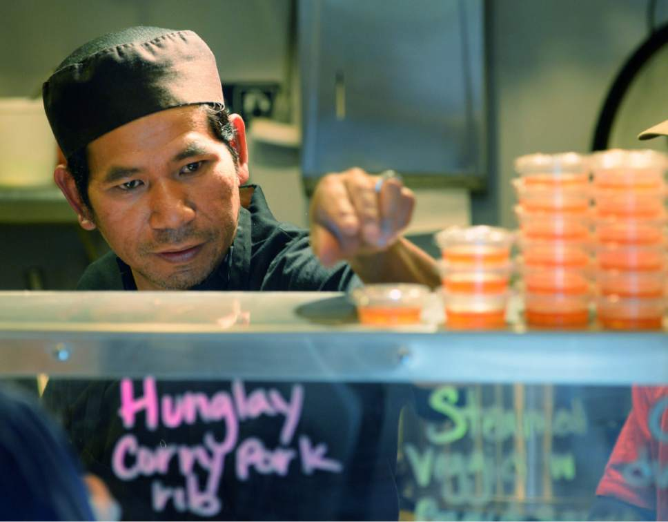 Steve Griffin / The Salt Lake Tribune Wichai Charoen cooks at the new Laan Na Thai restaurant (north of Pioneer Park) in Salt Lake City on Friday, Oct. 14, 2016. It is the first stand-alone restaurant that Salt Lake City's Spice KItchen Incubator program has helped launch.