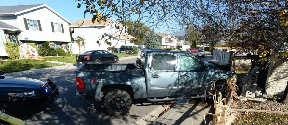 Steve Griffin / The Salt Lake Tribune   A bank robbery suspect was critically injured in a shoot-out with police in West Jordan, after crashing this truck into a cinderblock wall, following a chase after a robbery at a local credit union police reported in West Jordan, Utah Wednesday November, 02, 2016.