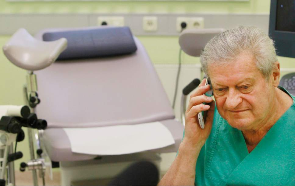 In this Oct. 27, 2016 photo gynecologist, doctor Janusz Rudzinski, a Pole who has lived and worked in Germany for 35 years, listens to a call of a Polish speaker asking about a possibility to have an abortion in his surgery at the city hospital in Prenzlau, Germany. Up to 20 women from Poland come to the hospital every week to terminate pregnancy because Poland's law, one of the most restrictive in Europe, bans abortion except for cases when the woman's health or life is in danger, the pregnancy results from crime like rape or the fetus is incurably damaged.  (AP Photo/Czarek Sokolowski)