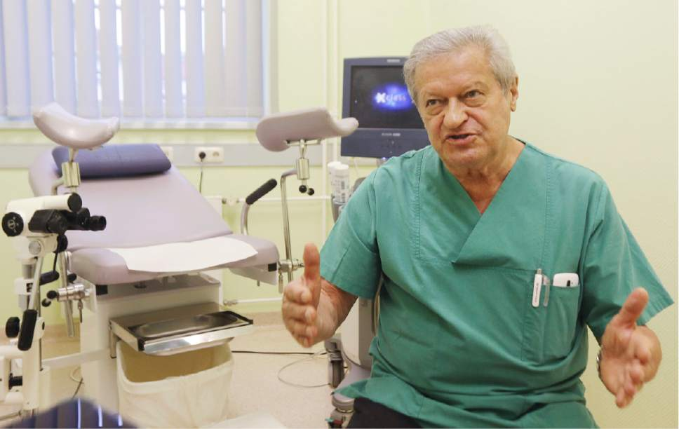 In this Oct. 27, 2016 photo gynecologist, doctor Janusz Rudzinski, a Pole who has lived and worked in Germany for 35 years, speaks during an interview in his surgery at the city hospital in Prenzlau, Germany. Up to 20 women from Poland come to the hospital every week to terminate pregnancy because Poland's law, one of the most restrictive in Europe, bans abortion except for cases when the woman's health or life is in danger, the pregnancy results from crime like rape or the fetus is incurably damaged.  (AP Photo/Czarek Sokolowski)