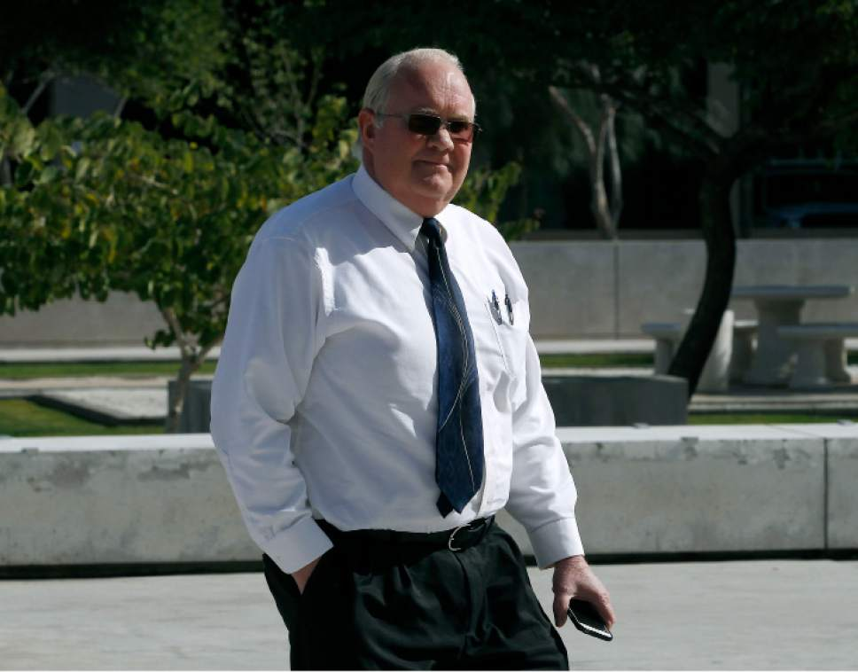 Hildale, Utah mayor Phillip Barlow arrives at the Sandra Day O'Connor United States District Court where a federal civil rights trial against the polygamous towns of Hildale and Colorado City, Ariz., which are located on the Arizona-Utah line, is set to begin, Tuesday, Jan. 19, 2016, in Phoenix. The jury selection is set to begin Tuesday at the trial that will examine allegations that the towns discriminated against people who aren't part of the communities' dominant religious sect.  (AP Photo/Ralph Freso)