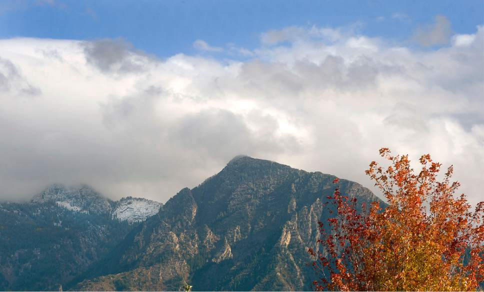 Al Hartmann  |  The Salt Lake Tribune Leaves in Salt Lake are beginning to turn color.  A hole in between this week's storms lights up the Mount Olympus and reveals snow in the higher peaks of the Wasatch Mountains.