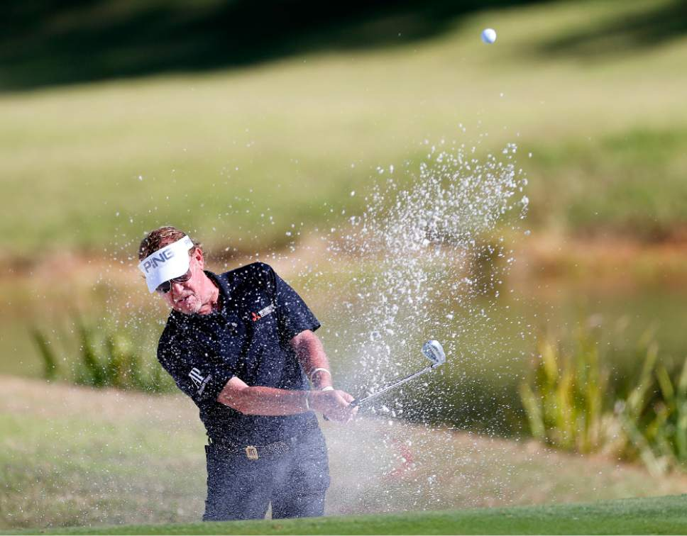 Miguel Angel Jimenez gets out of the sand on one during a PGA Tour Champions event at the Country Club of Virginia's James River Course in the Dominion Charity Classic golf tournament in Henrico, Va., Friday, Nov. 4, 2016. (Mark Gormus/Richmond Times-Dispatch via AP)