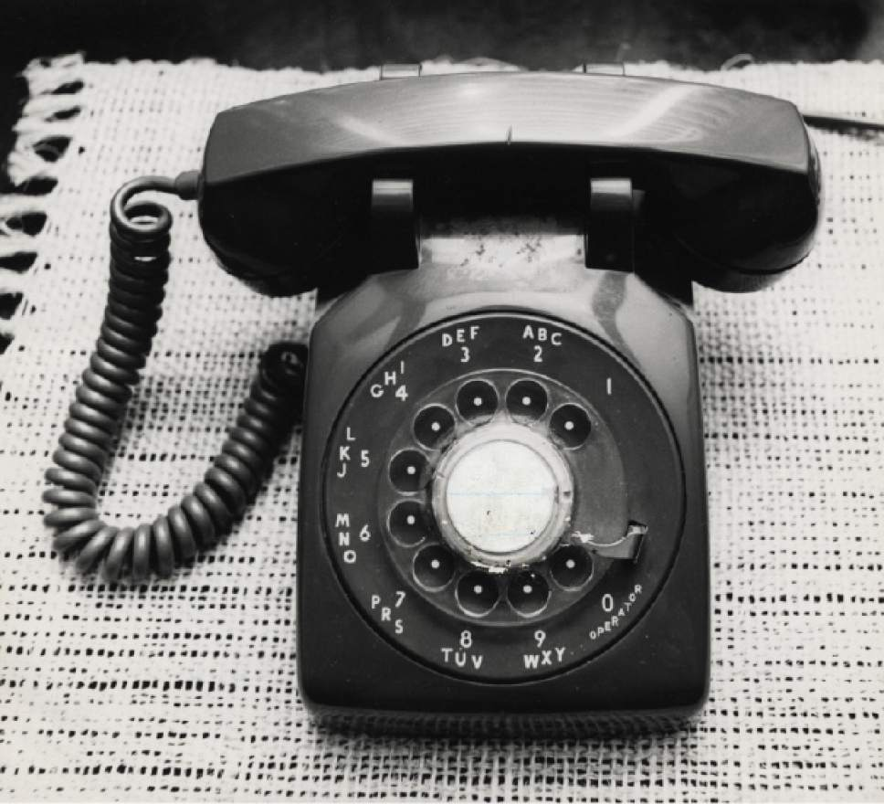 FILE - This undated photo shows a rotary dial telephone in Houston.  The fight between Apple and the FBI over access to a San Bernardino killer's iPhone isn't the first time industry and government have tangled over privacy and security. Every revolution in communications technology has sparked new fights over its use that changed the course of law enforcement, surveillance and civil liberties.  (Dan Hardy/Houston Chronicle via AP) MANDATORY CREDIT