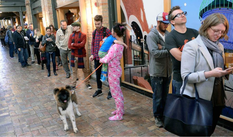 Al Hartmann     The Salt Lake Tribune Ashley Carter, her young son Kayzenn and puppy Gypsy make a morning of it as they wait in line in their pajamas at the polling station at Trolley Square in Salt Lake City on election day Tuesday Nov. 8.  Poll workers are in for a long day.  People were waiting in line at 6 a.m. as they were setting up the station.  Lines were long at 8:30 a.m. with a wait of at least an hour to vote.