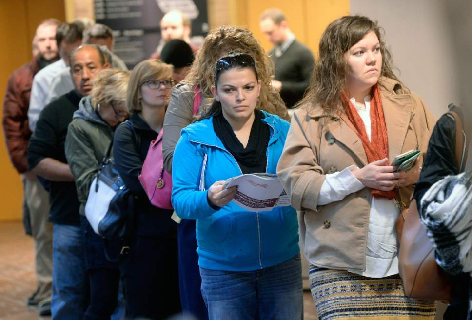 Al Hartmann     The Salt Lake Tribune People line up at the Salt Lake County Building  on election day Tuesday Nov. 8 in Salt Lake City to vote before work.  Lines were long but moving steady.   The wait was less than 30 minutes to vote.