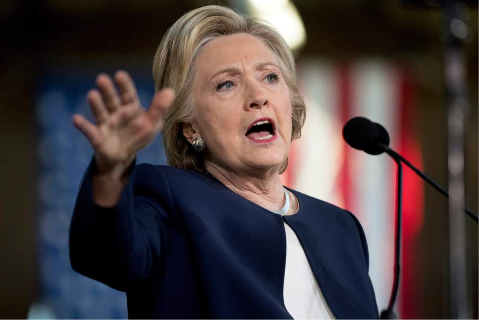 In this Nov. 4, 2016, photo, Democratic presidential candidate Hillary Clinton speaks at a rally at Eastern Market in Detroit. If she gets to the White House, Clinton has a daunting to-do list. And it's made more complicated because she's laid out some very specific promises. (AP Photo/Andrew Harnik)