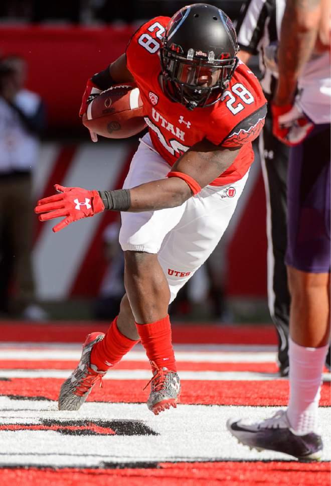 Trent Nelson  |  The Salt Lake Tribune Utah Utes running back Joe Williams (28) scores a touchdown as the University of Utah faces Washington, college football at Rice-Eccles Stadium in Salt Lake City, Saturday October 29, 2016.
