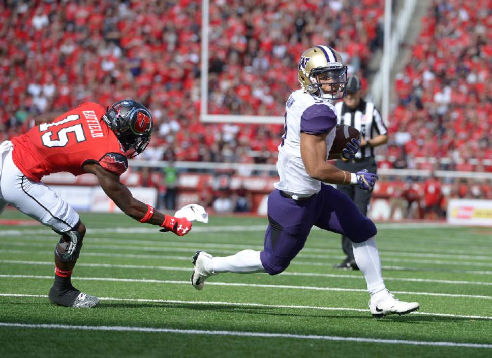 Leah Hogsten  |  The Salt Lake Tribune Washington Huskies running back Myles Gaskin (9) can't be stopped by Utah Utes defensive back Dominique Hatfield (15) on his touchdown run. University of Washington Huskies lead University of Utah Utes 14-10 during the first half of their game at Rice-Eccles Stadium, Saturday, October 29, 2016.