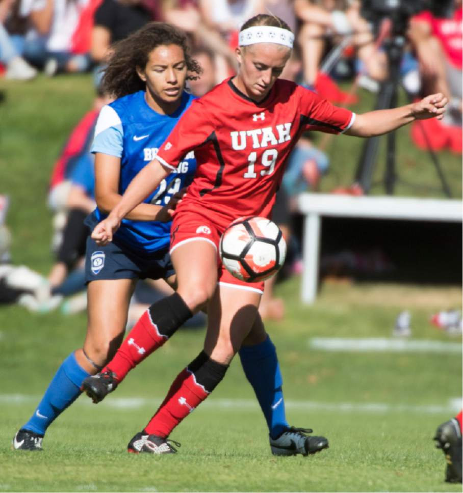Rick Egan  |  The Salt Lake Tribune  BYU Alyssa Jefferson (29) defends as Utah Hailey Skolmoski (19) kicks the ball, in soccer action, BYU vs. Utah, at the Ute soccer field, Monday, September 5, 2016.