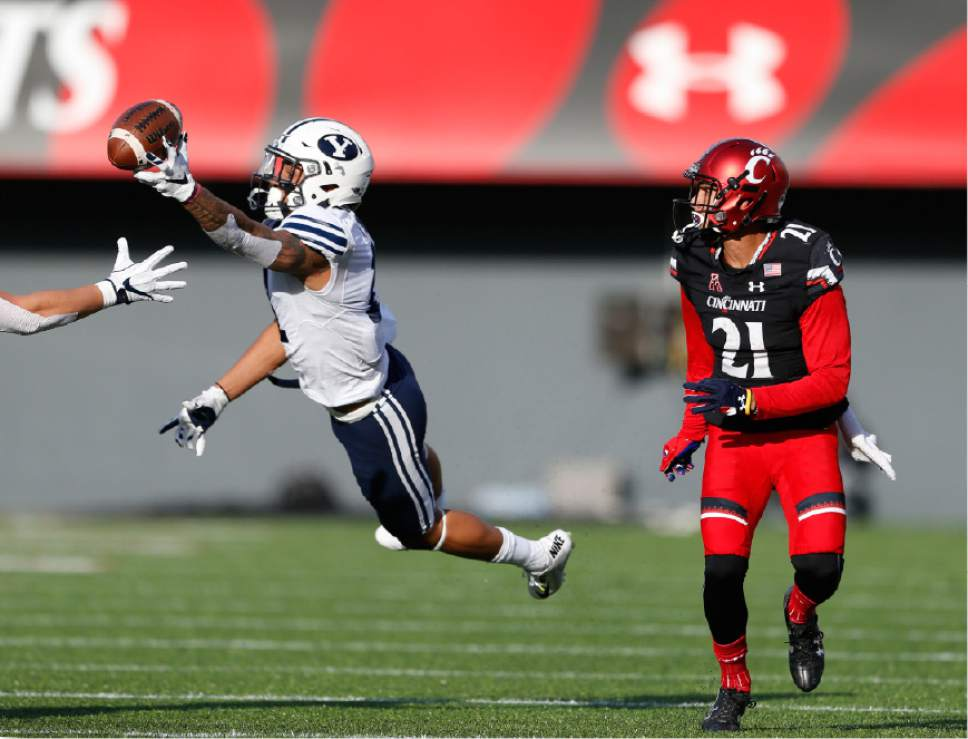 Brigham Young defensive back Troy Warner, left, breaks up a pass intended for Cincinnati wide receiver Devin Gray (21) during the first half of an NCAA college football game, Saturday, Nov. 5, 2016, in Cincinnati. (AP Photo/Gary Landers)