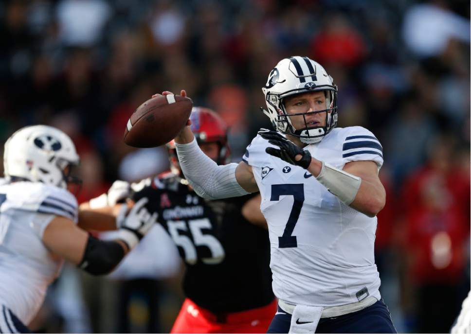 Brigham Young quarterback Taysom Hill (7) throws against Cincinnati during the first half of an NCAA college football game, Saturday, Nov. 5, 2016, in Cincinnati. (AP Photo/Gary Landers)
