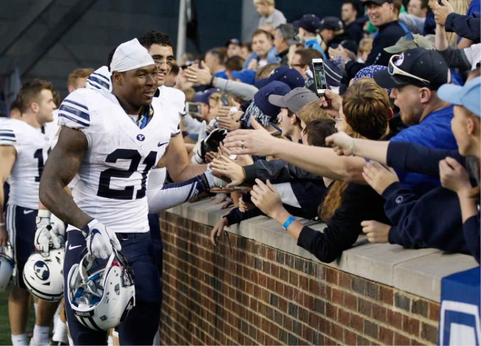 Brigham Young running back Jamaal Williams (21) greets fans following the team's 20-3 win over Cincinnati in an NCAA college football game, Saturday, Nov. 5, 2016, in Cincinnati. (AP Photo/Gary Landers)