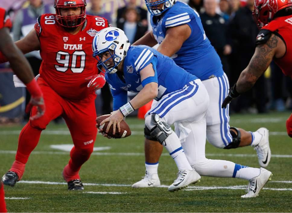 BYU quarterback Tanner Mangum runs for a touchdown against Utah during the second half of the Las Vegas Bowl NCAA college football game Saturday, Dec. 19, 2015, in Las Vegas. Utah won 35-28. (AP Photo/John Locher)