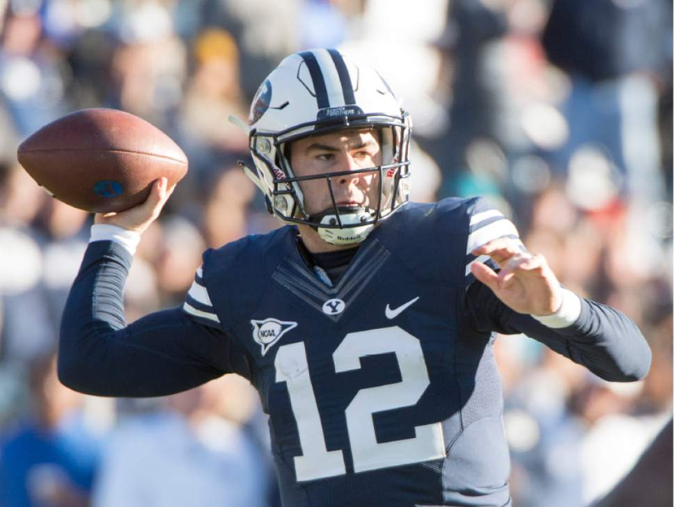 Rick Egan     The Salt Lake Tribune  Brigham Young Cougars quarterback Tanner Mangum (12) throws down field, in football action, as BYU defeated the Fresno Bulldogs 52 -10, at Lavell Edwards stadium, Tuesday, November 21, 2015.
