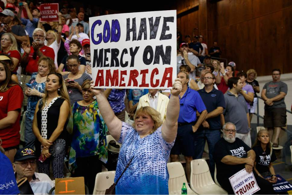 Supporters of Republican presidential candidate Donald Trump listen as he speaks during a campaign rally, Monday, Nov. 7, 2016, in Sarasota, Fla. (AP Photo/ Evan Vucci)
