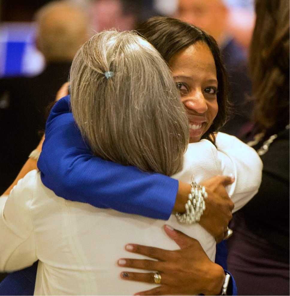 Rick Egan  |  The Salt Lake Tribune  Mia Love gets a hug from Sandy Webb, at Noah's, in South Jordan, Tuesday, November 8, 2016.