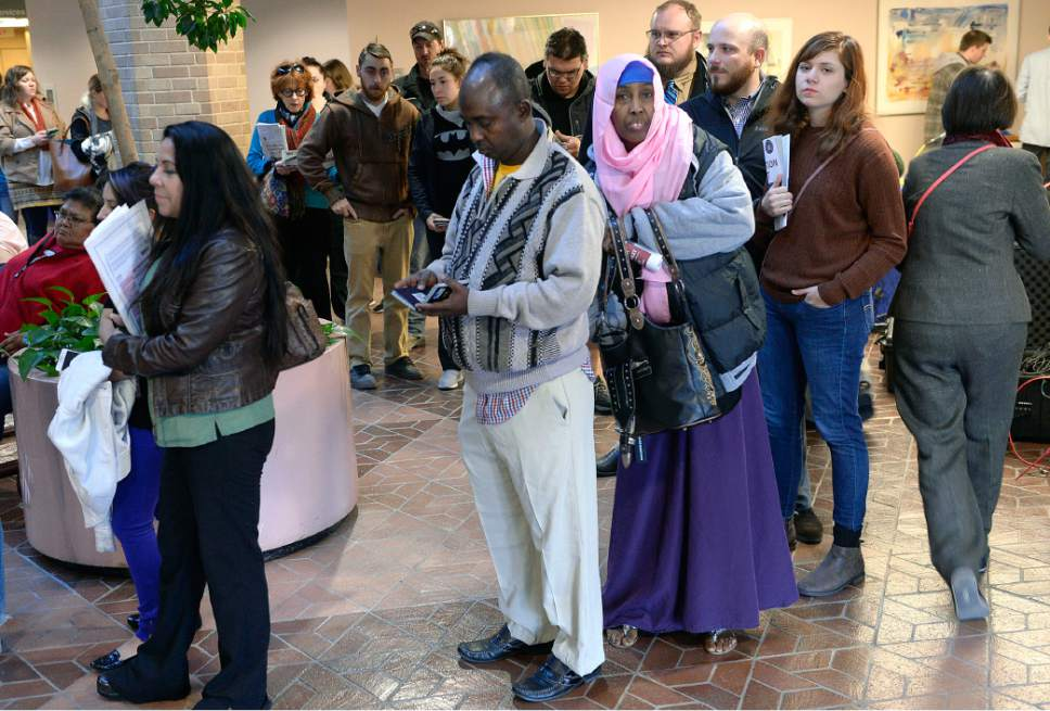 Al Hartmann  |  The Salt Lake Tribune People line up at the Salt Lake County Building  on election day Tuesday Nov. 8 in Salt Lake City to vote before work.  Lines were long but moving steady.   The wait was less than 30 minutes to vote.